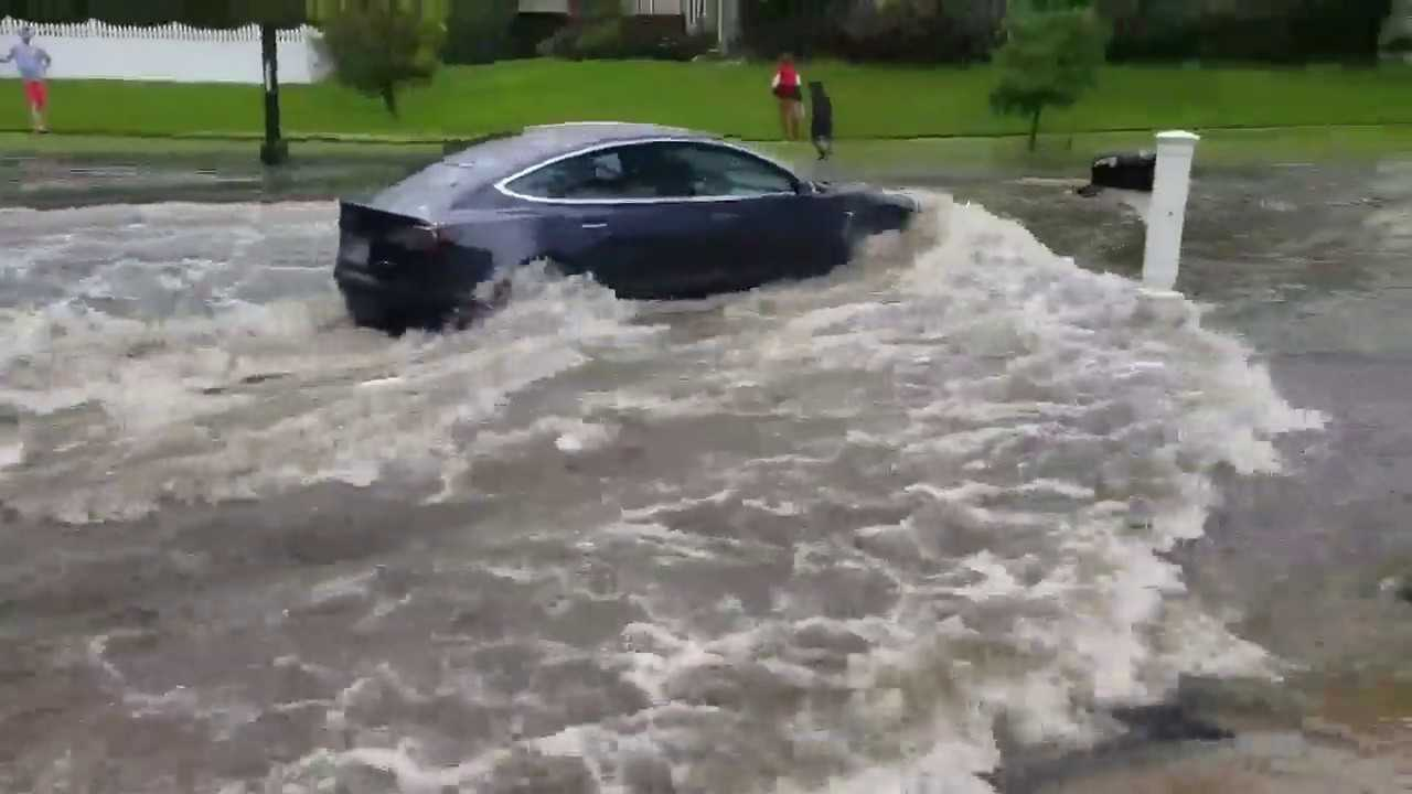 Watch This Tesla Model 3 Fly Down A Flooded Road: Video