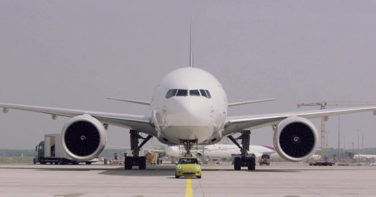 MINI Cooper SE gets teased towing a Boeing 777F
