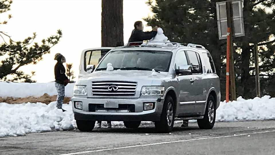 Confused About Winter, Californians Are Building Snowmen on Cars and Driving Around