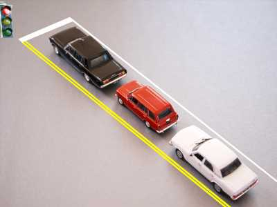 Autoweek Asks: How much space do you keep between the car ahead at red lights?