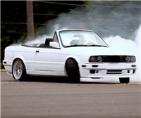 A Tesla-Swapped E30 BMW Means You'll Never Miss a Yellow Light Again