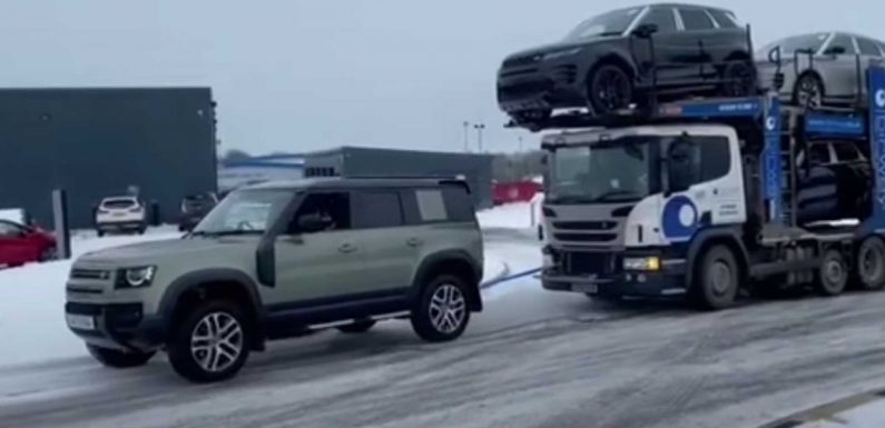 Car Trailer With Six Land Rovers Pulled By New Defender On Icy Road