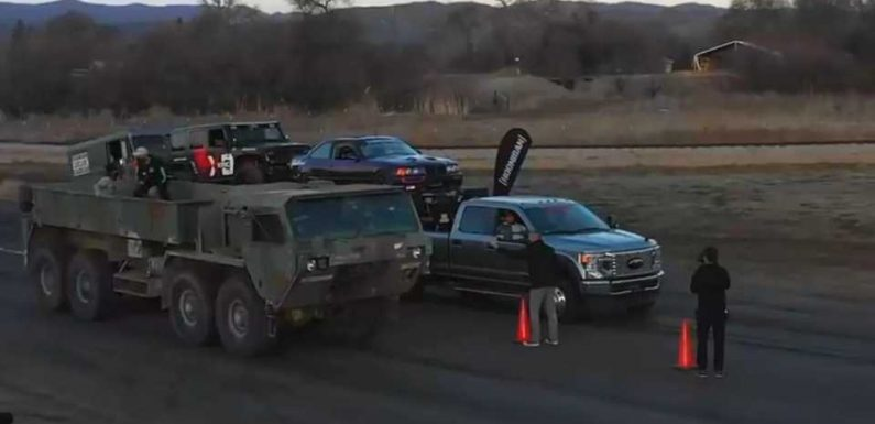 Watch an 8×8 HEMTT Military Truck Drag Race a Ford F-450 Towing Three Cars