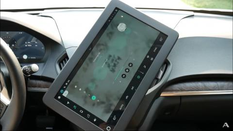 Mitsubishi Electric working on a rotating infotainment system
