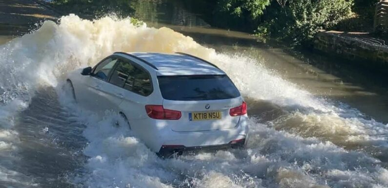 Watch Drivers Plough Through Deep Water Without Slowing Down